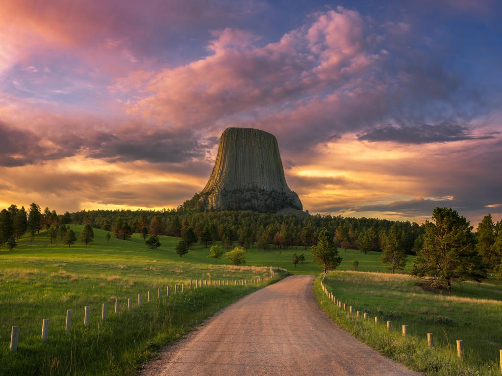 The Devils Tower rock formation in Wyoming at sunrise.