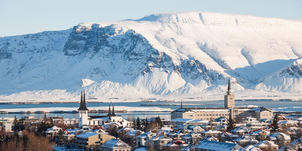 Cityscape view of Reykjavik from Perlan Dome, Iceland, with snow covered mountain in the backround