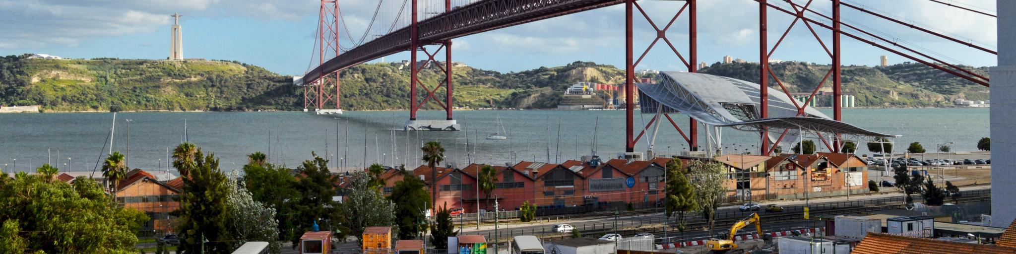 LX Factory under Ponte 25 de Abril suspension bridge