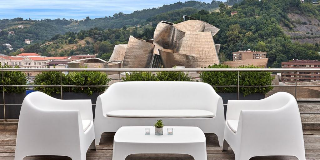 Terrace on the roof of the Gran Hotel Domine Bilbao overlooking the Guggenheim