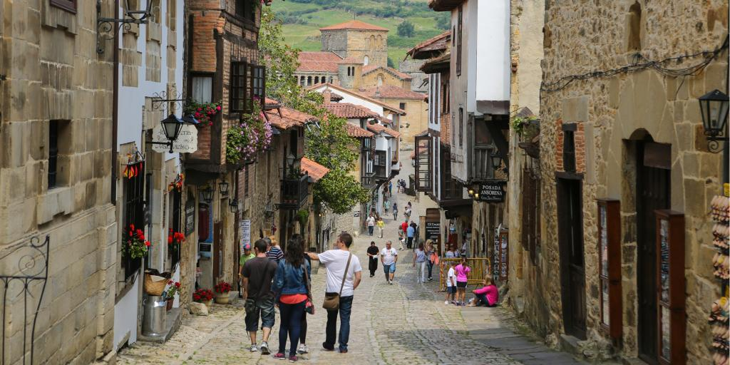 People walking down a narrow street in Santillana del Mar