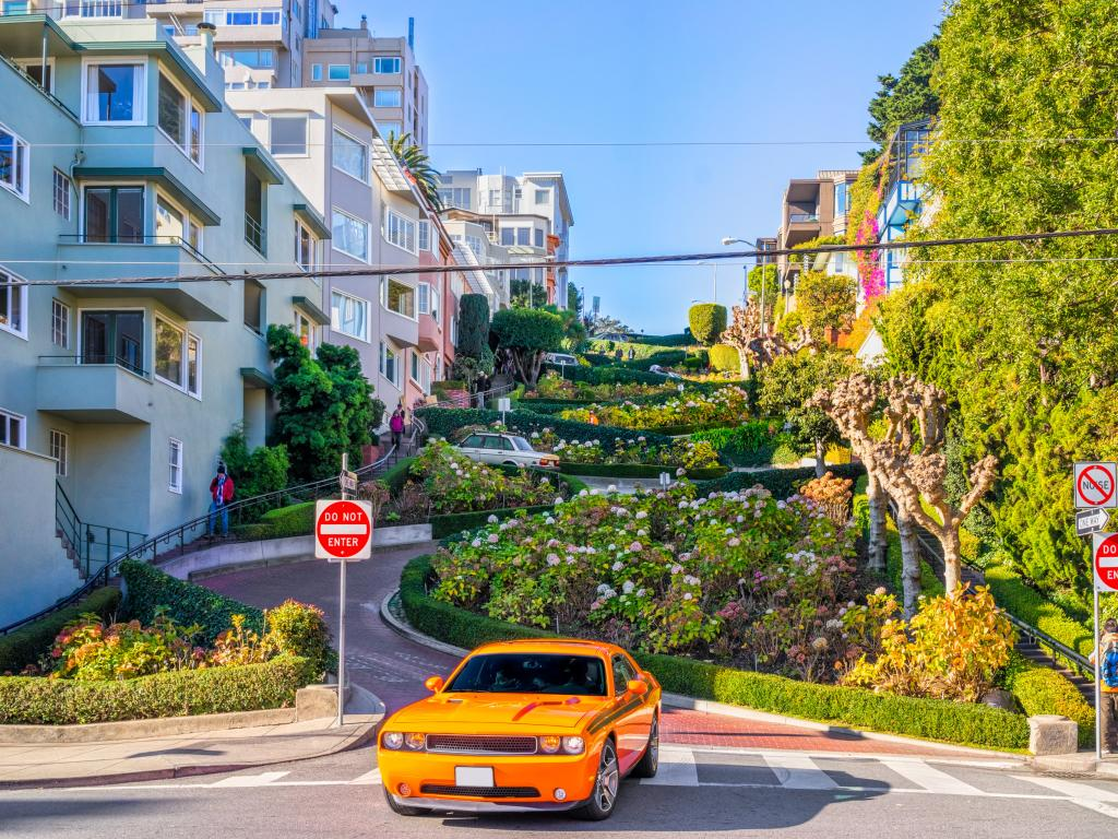 Car driving down the steep Lombard Street in San Francisco
