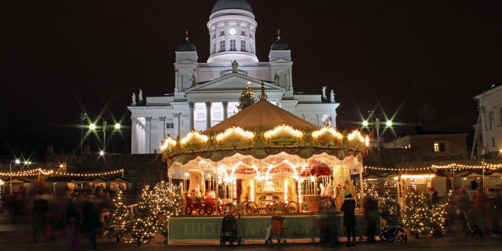 Carousel and stalls at Helsinki Christmas market, Finland