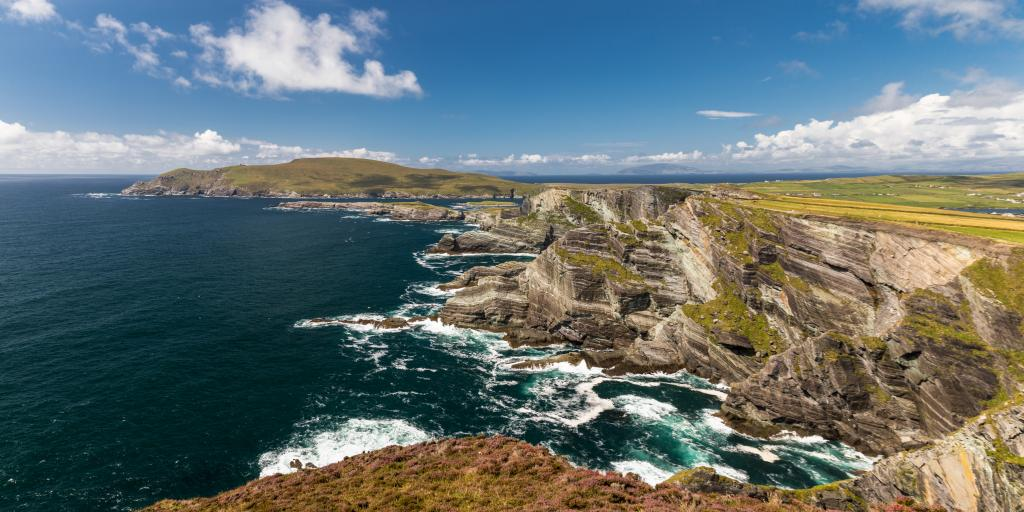 Waves crash against the spectacular cliffs along the Ring of Kerry in Ireland