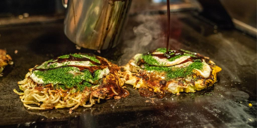 Okonomiyaki on a hot plate in Osaka