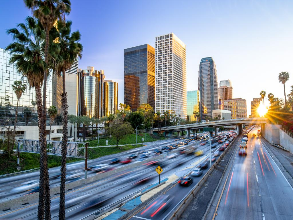 Los Angeles evening sunset highway traffic skyline buildings