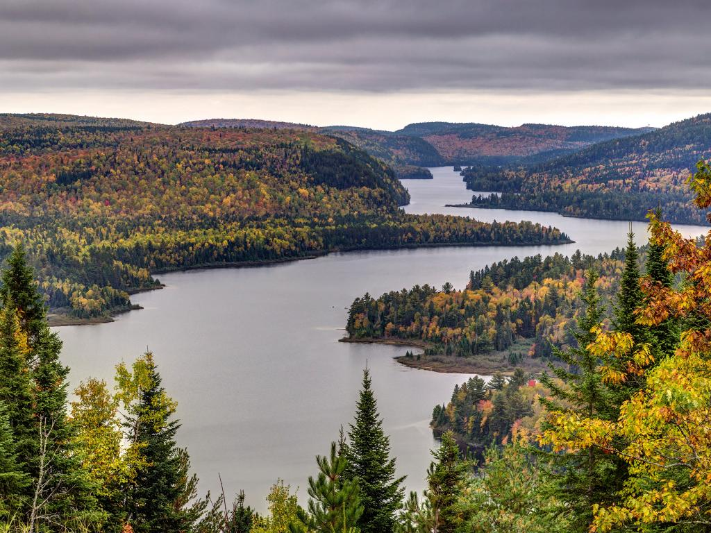 Lake surrounded by a forest with autumn leaves in La Mauricie National Park in Quebec, Canada.