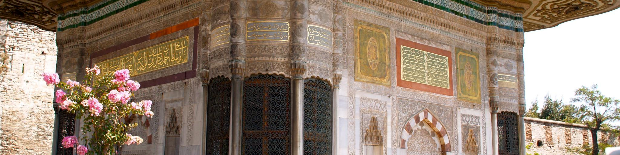Visitors walk around the ornately decorated Topkapi Palace in Istanbul, Turkey