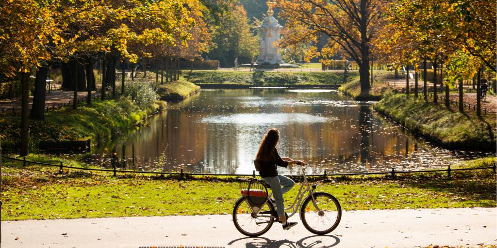 Woman cycling in Berlin's Tiergarten park