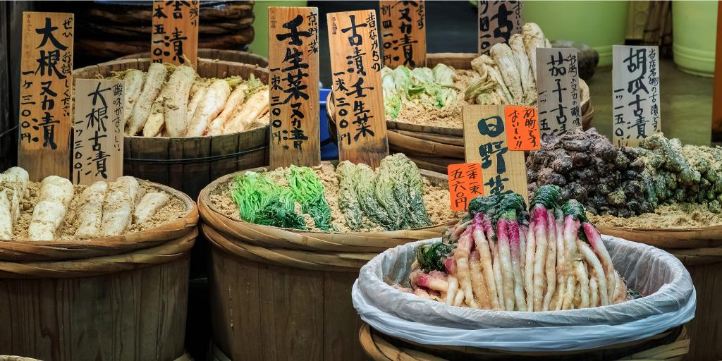 Vegetables on sale in baskets at  Nishiki Market, Kyoto