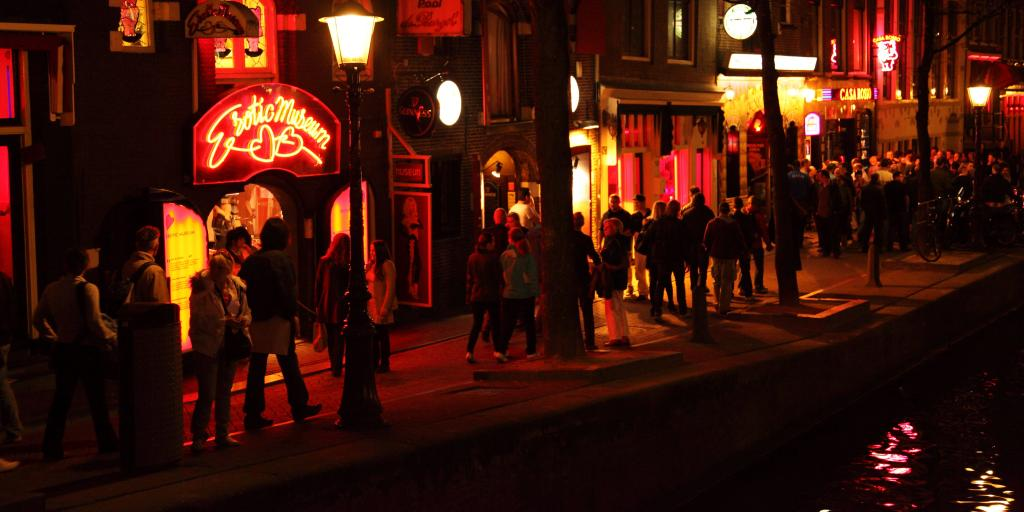 People strolling through Amsterdam's Red Light District at night