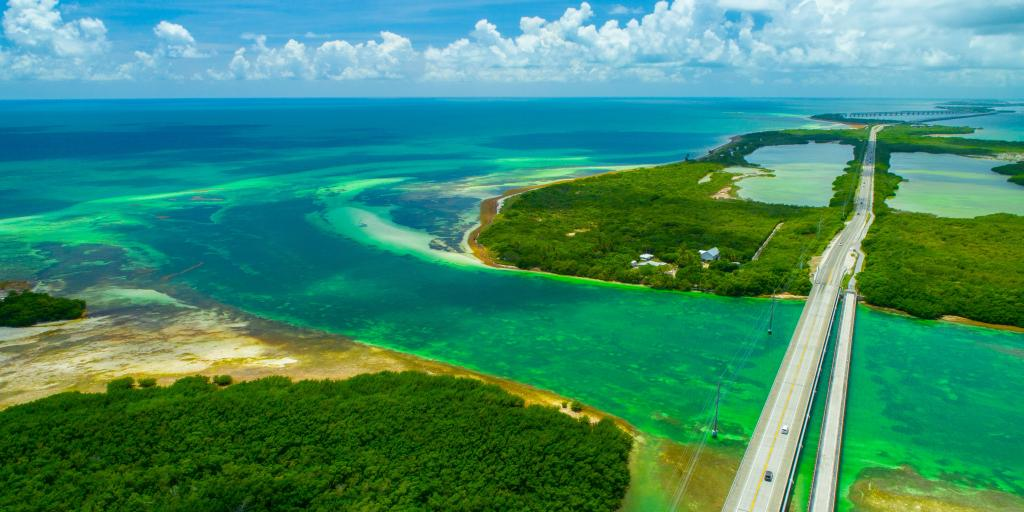 An Aerial View Overseas Highway Surrounded By Green And Blue Waters Sandy Islands As It
