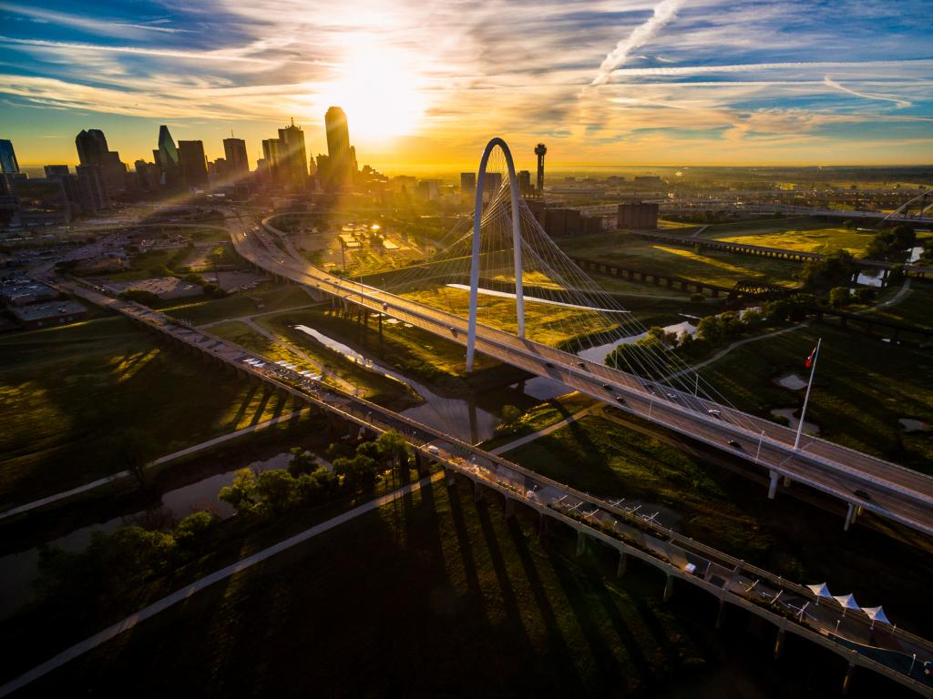 Margaret Hunt Hill Bridge with amazing views of downtown Dallas at sunset