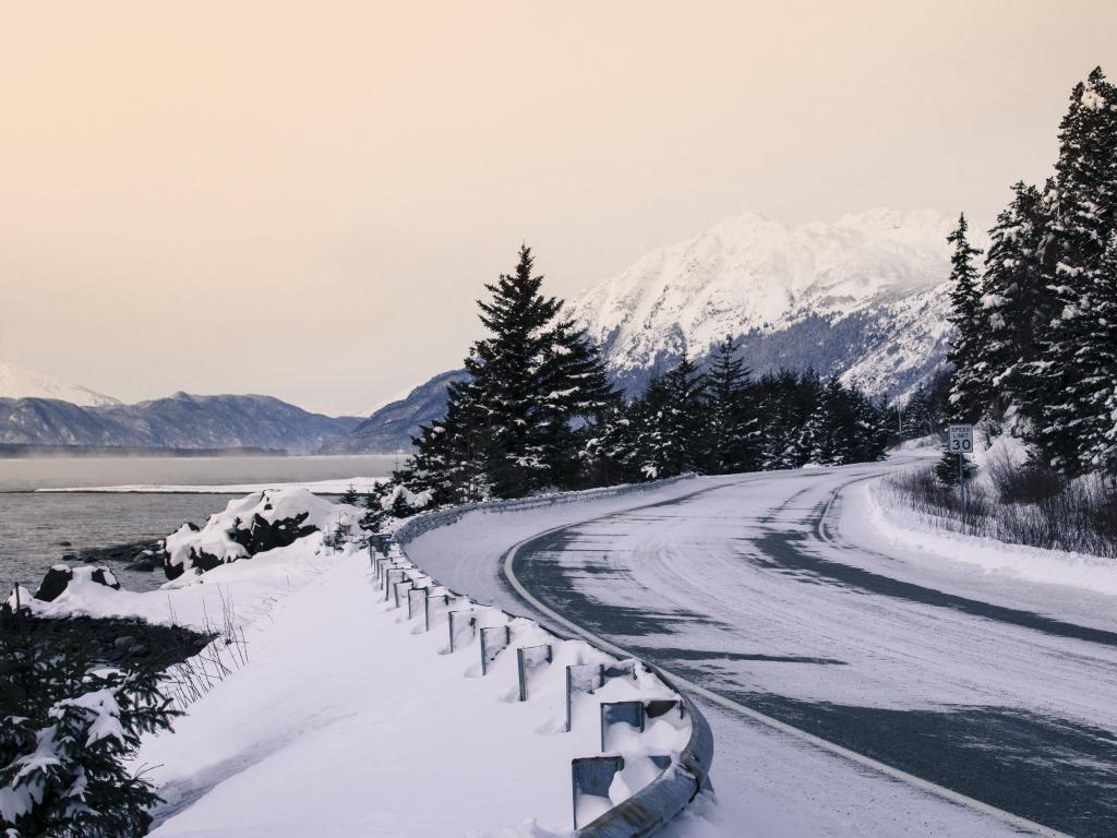 A road with a dusting of snow in the winter near Haines, Alaska