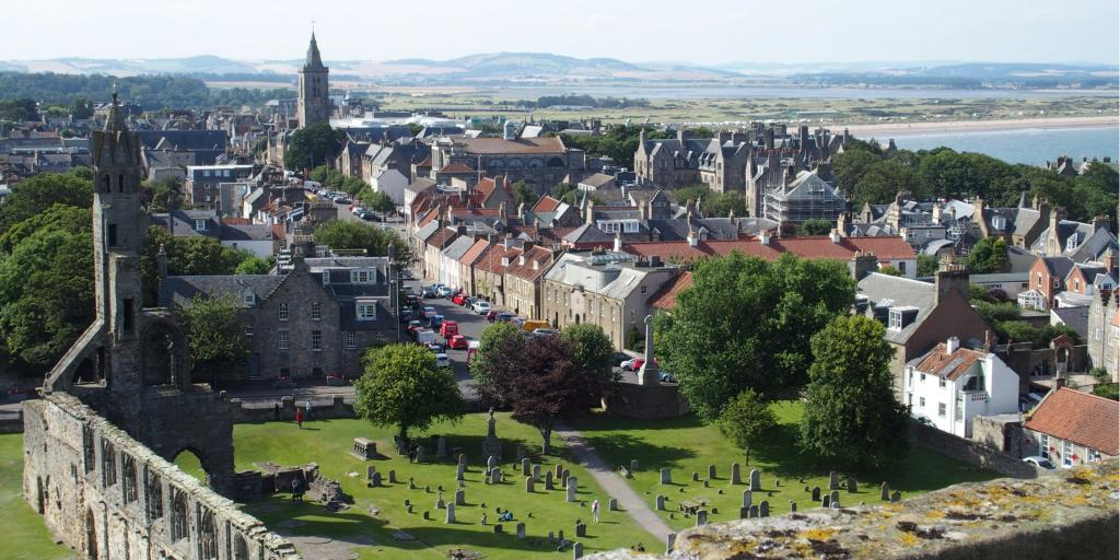 Aerial view of the city of St Andrews in Scotland, with the ruins of the gothic cathedral in the foreground