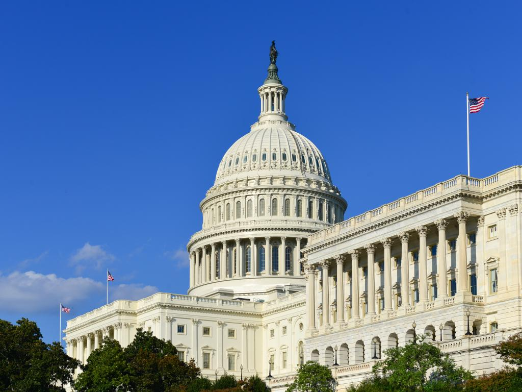 United States Capitol building on a bright summer day with a clear blue sky in Washington D.C.