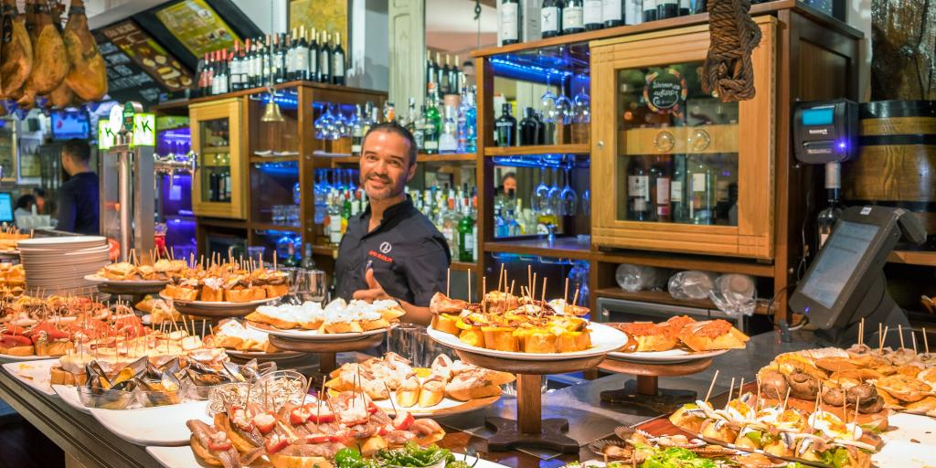 Pintxos being served in San Sebastian bar - Basque country in Spain