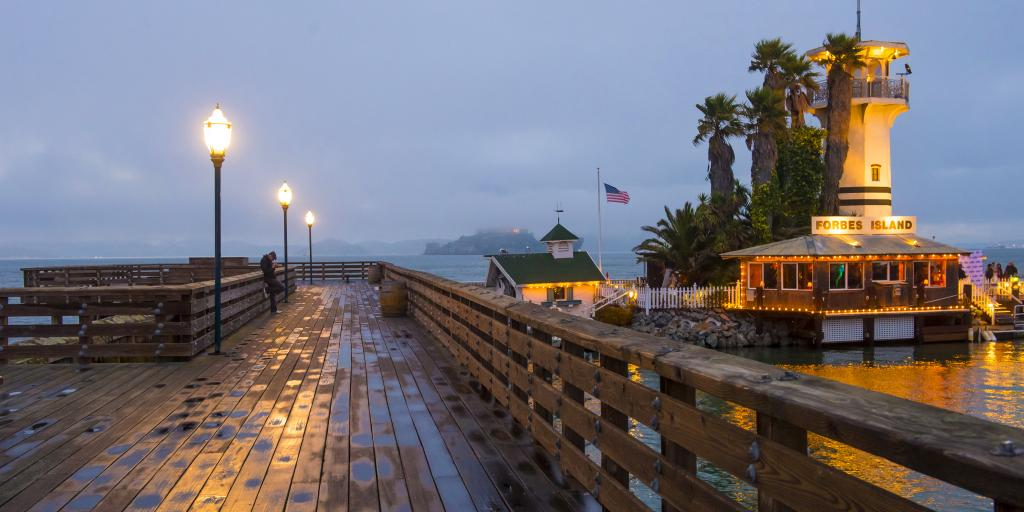Pier 41 (next to Pier 39) sticking out into a misty San Francisco Bay with Alcatraz Island in the background.