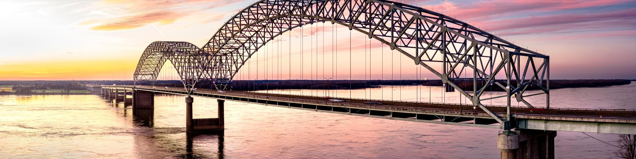 Hernando de Soto Bridge connecting Memphis, Tennessee with West Memphis, Arkansas at sunset.