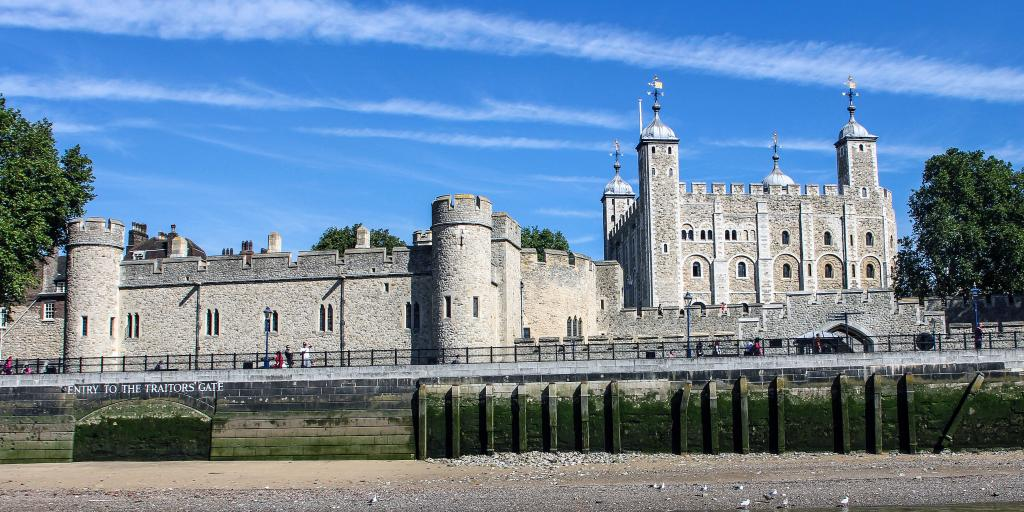 The Tower of London across the Thames at low tide