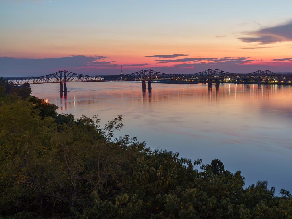 Natchez-Vidalia bridge across the Mississippi River at sunset in Natchez, Mississippi.