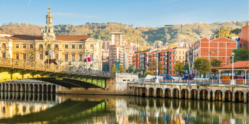 Reflection of the buildings on the river in Bilbao, Spain, on a sunny day