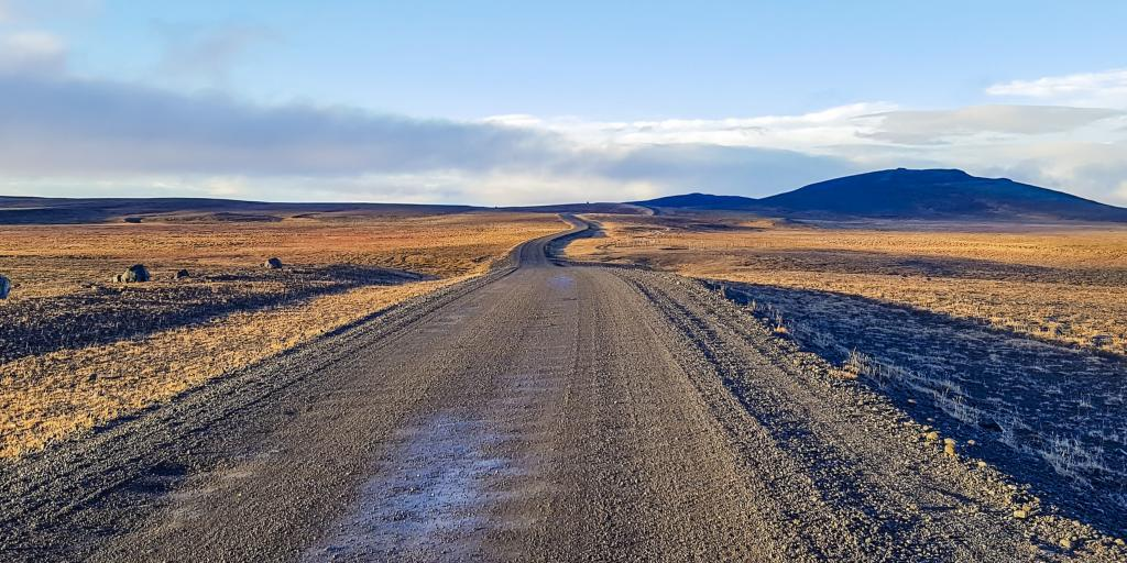F35 road winding across the land with mountains in the distance in Iceland