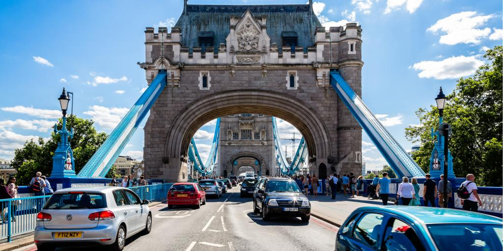 Cars drive on the left side of the road over Tower Bridge in London