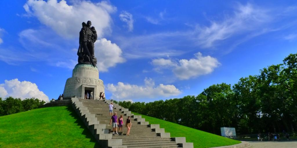 The impressive Soviet Memorial statue sits on a hill in Treptower Park on a sunny day in Berlin