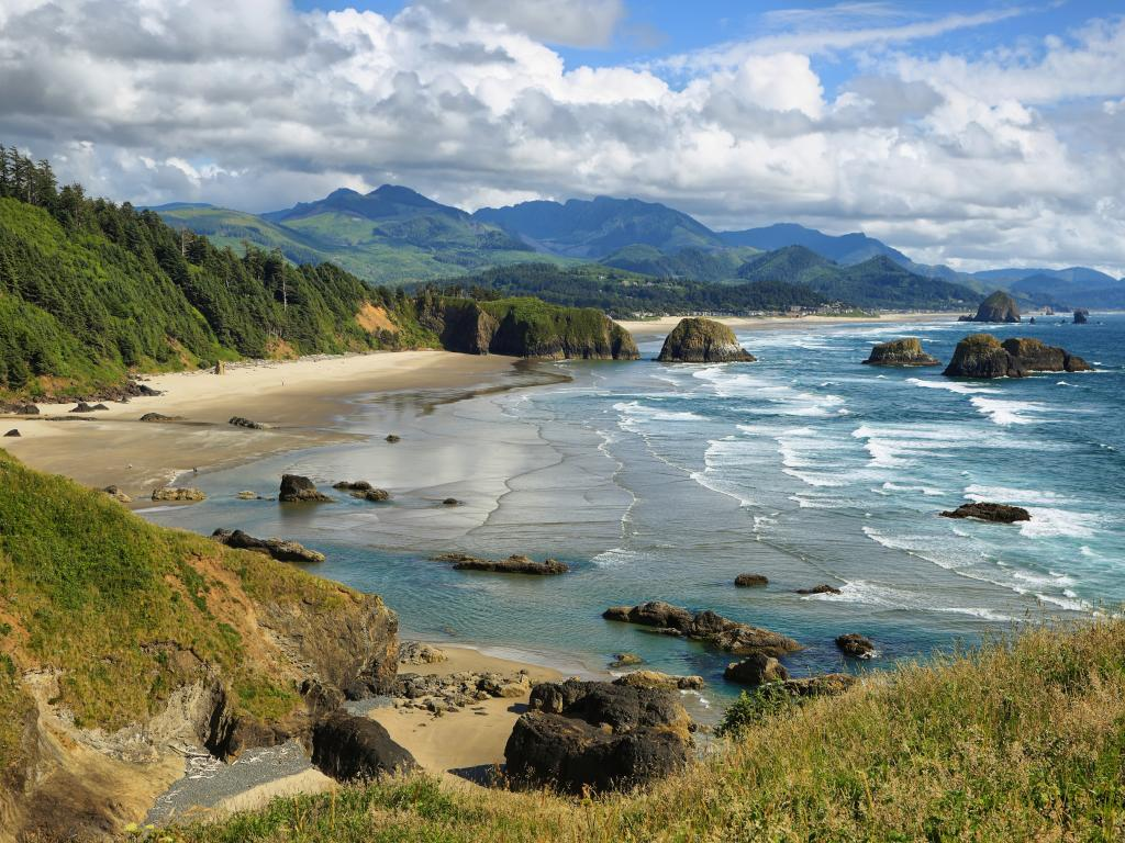Cannon Beach and Indian Beach in Oregon with rocks standing in the water just off the coast.