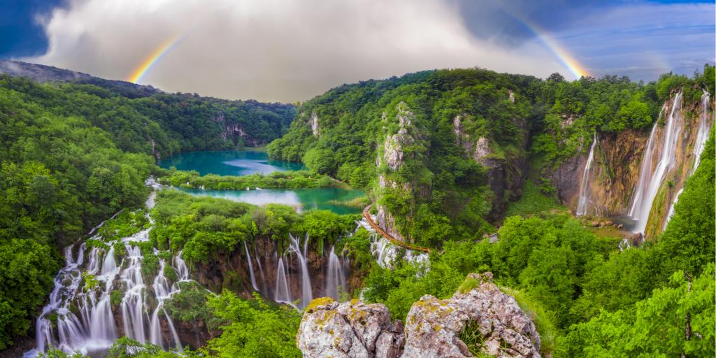 A rainbow over the stunning waterfalls of Plitvice Lakes in Croatia