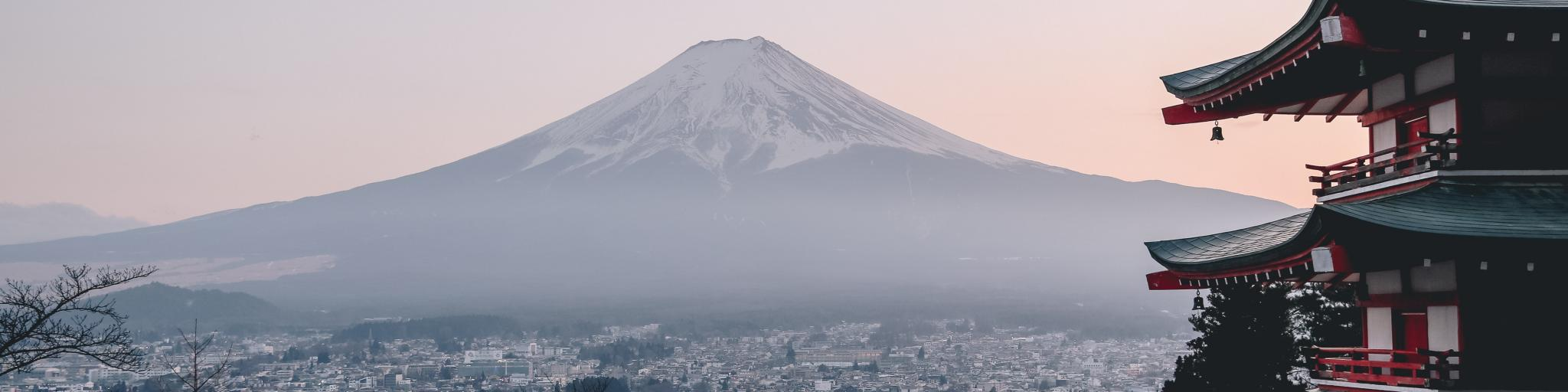 Mount Fuji in the haze towering over the city of Tokyo, Japan