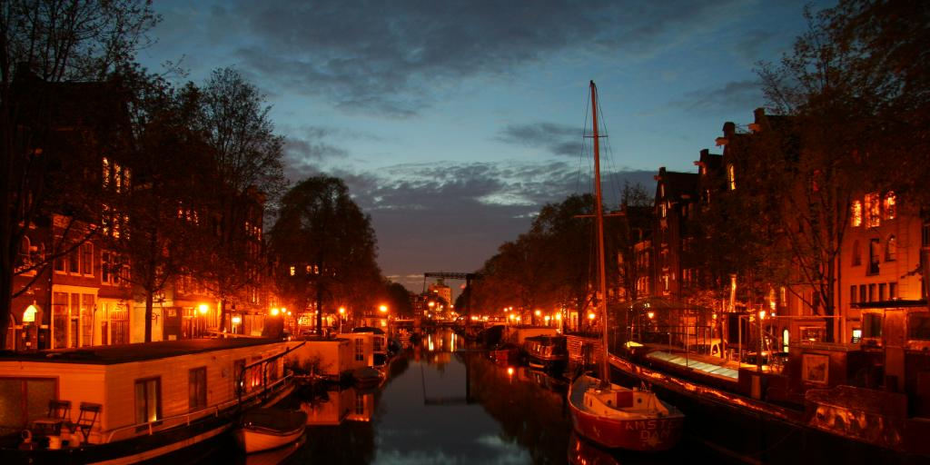 Red light illuminates the Jordaan area of Amsterdam at night