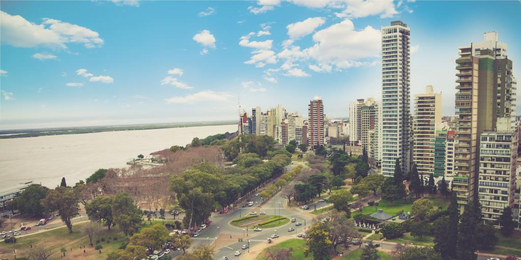 panoramic view cityscape of the city of Rosario, Argentina with the water on one side and high rise buildings on the other.
