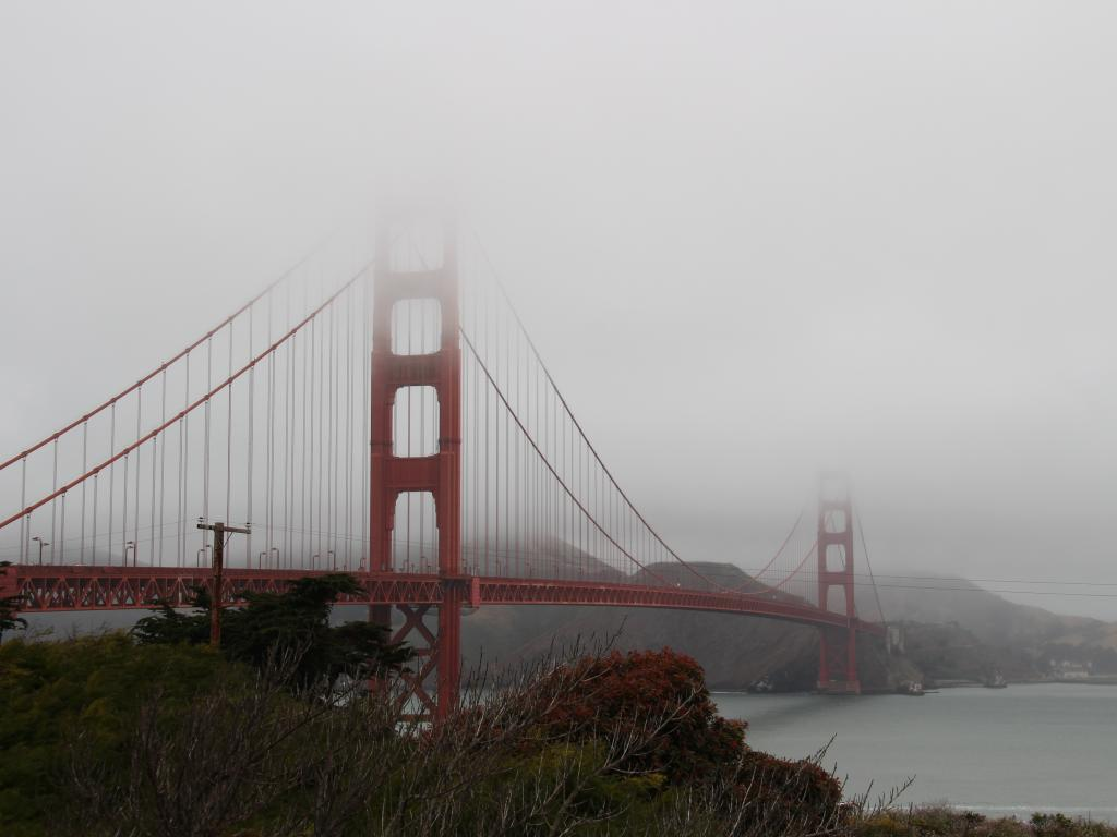 June Gloom in San Francisco with heavy fog setting on the city's Golden Gate Bridge
