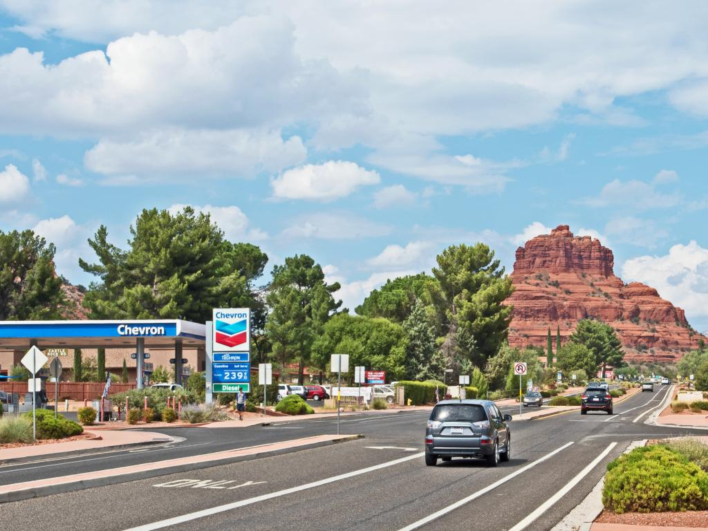 Oak Creek Village along route 179 towards Sedona on a sunny morning with Bell Rock in the background.