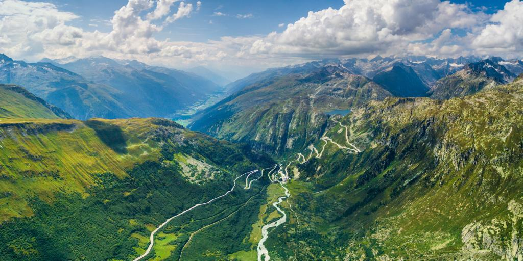 Aerial view of the Furka Pass hairpin bends on the green mountain side