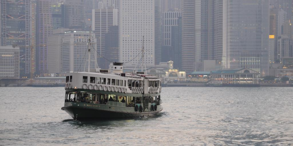 The Star Ferry crossing the harbour in Hong Kong with skyscrapers in the background