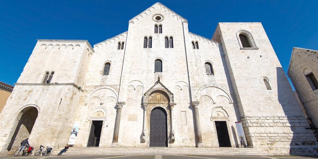 The outside of the Basilica di San Nicola, Bari against a blue sky