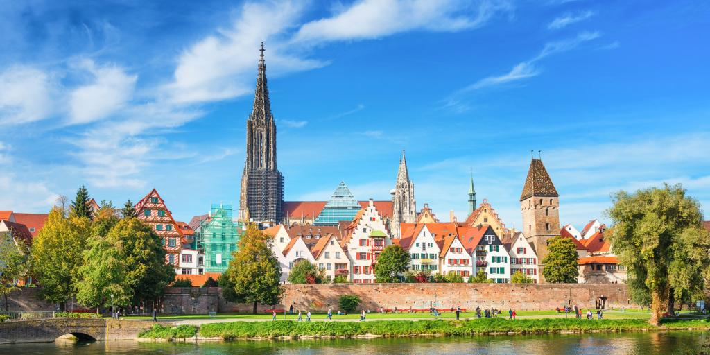 Houses along the waterfront in Ulm, Germany, with the spire of Ulm Minster in the background