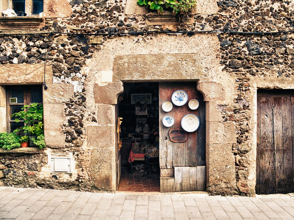 A traditional doorway with hanging plates in Santa Pau, Catalonia