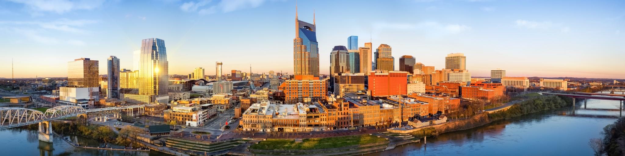 Nashville skyline at sunrise with the Cumberland River passing Downtown