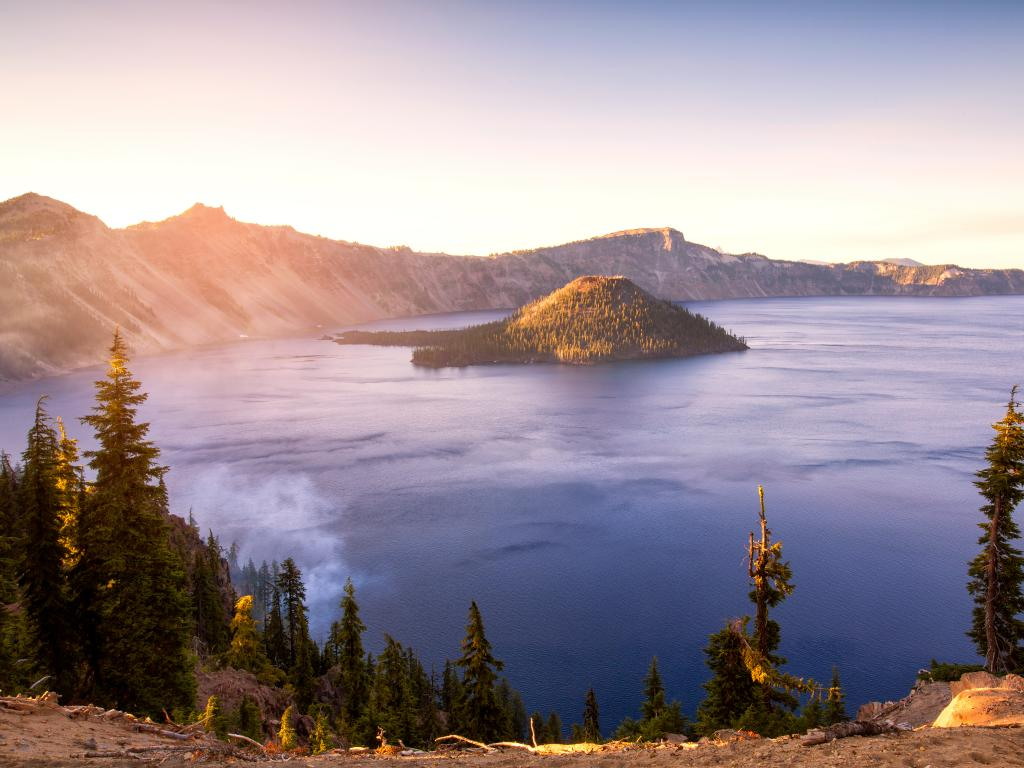 Panorama of Crater Lake National Park in Oregon at sunrise.