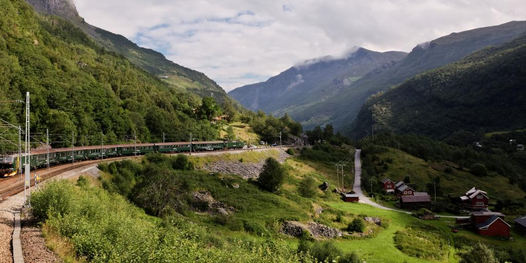 The Flam railway winds around a lush green hill near the west coast of Norway