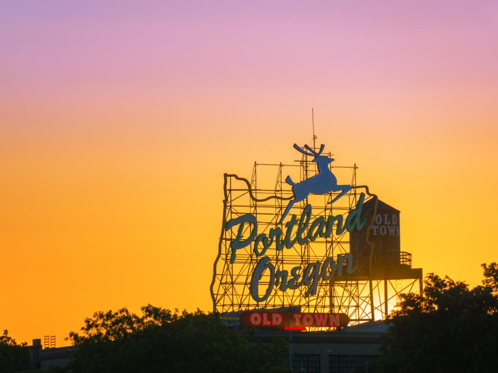 Sunset over the iconic Portland, Oregon, sign in downtown Portland