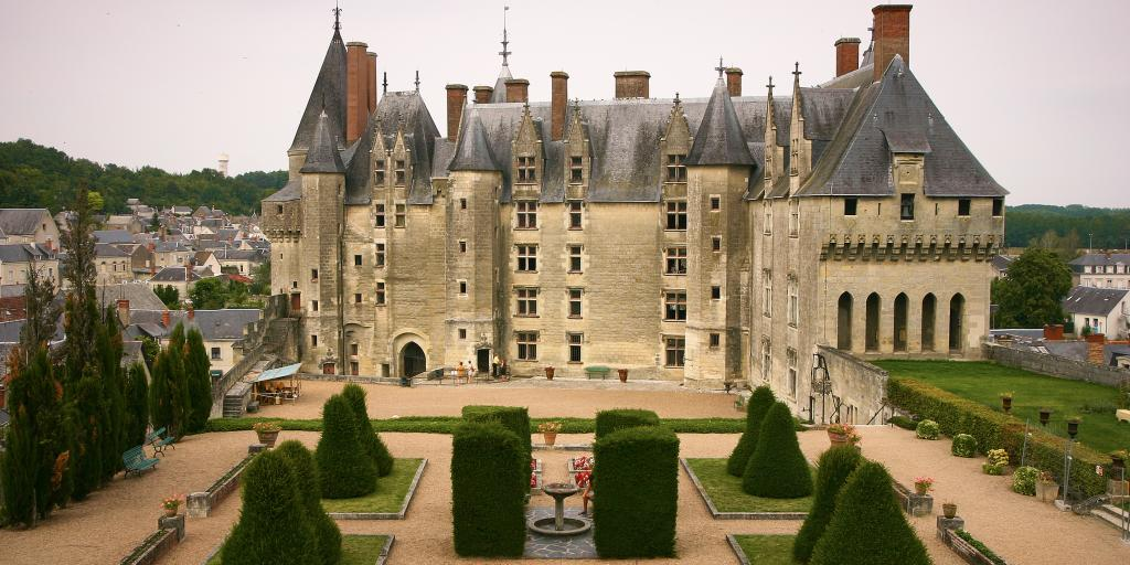 A grand chateau and its manicured garden in Loire Valley, France