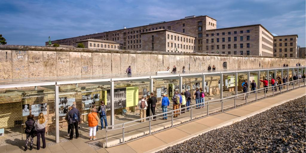 People viewing the Berlin Wall remains and the museum and documentation centre at the Topography of Terror Foundation