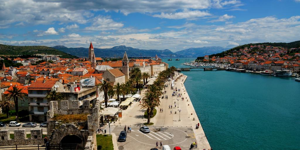 The orange roofs of Trogir contrast against the blue harbour