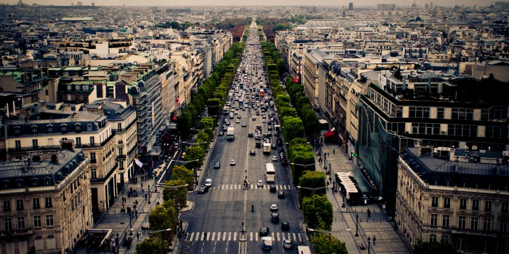 Cars driving along the tree-lined Champs Elysees in Paris, France