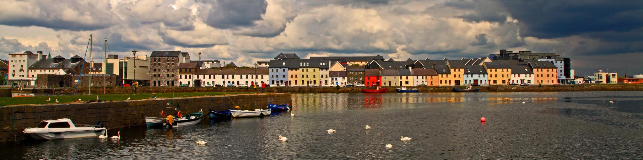 Colourful houses line the banks of the River Corrib in Galway